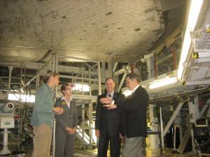 KSC Director Bob Cabana telling the Congressman and I about the heat shield tiles and re-entry as we stand directly below one of the shuttle orbiters (Discovery or Endeavor?)