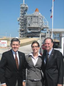Me with KSC Director and Astronaut Bob Cabana and my boss, Congressman Posey, and the stunning Atlantis Space Shuttle behind us.